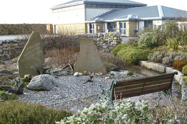 photo of the village hall and John Lennon Memorial Garden